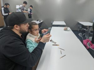 Kids are capturing images of Pocky sticks for the sequencing lesson, which teach them movements like going forward, backward and turn in right and left.
