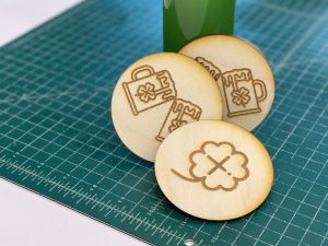 image that shows the project you can make. It is wooden coasters with st patricks day theme
